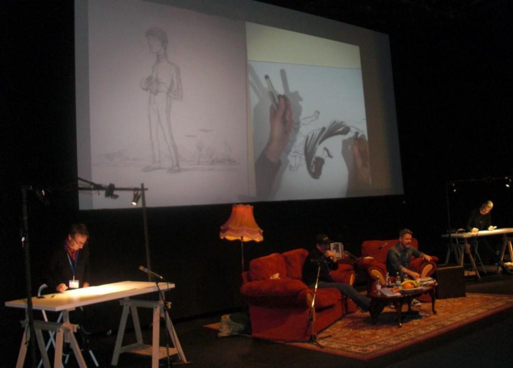 Ian McQue (tv) og Stuart Immonen (th) tegner, mens Darwyn Cooke bliver interviewet.