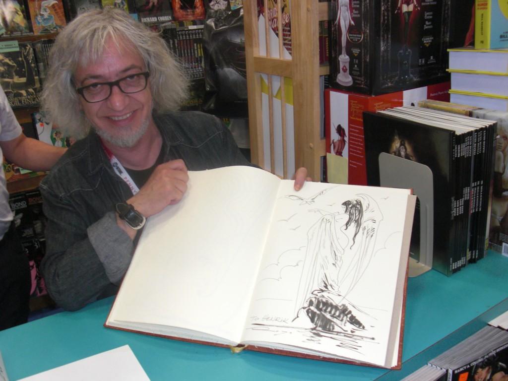 Bud Plant havde i år messe gæst Luis Royo til at komme forbi for at tegne og signere for sine fans 3 dage i træk. Jeg fik en meget fin tegning i min sketchbog!